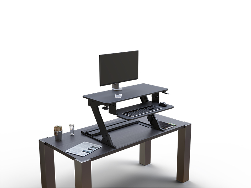 Solace Desktop on desk with conform single articulating arm and monitor